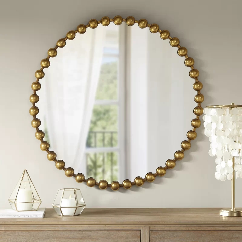 Black round metal wall mirror